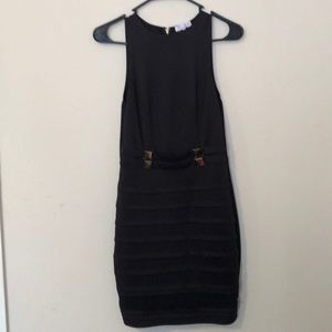 Black dress with gold plated design at midsection.